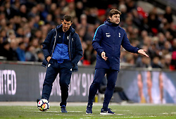 Tottenham Hotspur manager Mauricio Pochettino (right) gestures on the touchline whilst Watford manager Javi Gracia kicks the ball back on to the pitch