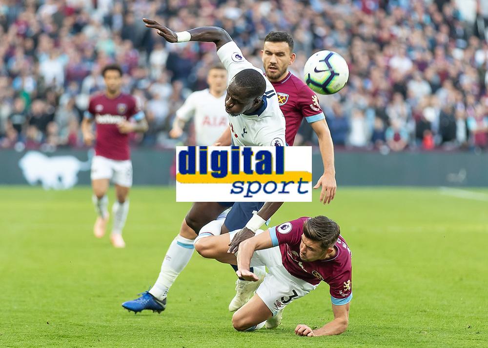 Football - 2018 / 2019 Premier League - West Ham United vs. Tottenham Hotspur<br /> <br /> Aaron Cresswell (West Ham United) tackles Moussa Sissoko (Tottenham FC) at the London Stadium<br /> <br /> COLORSPORT/DANIEL BEARHAM