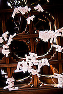 Knotted paper prayers at a temple in Tokyo, Japan.