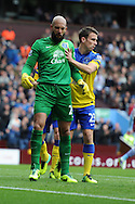 Everton keeper Tim Howard celebrates after he saves an early penalty taken by Villa's Christian Benteke. Barclays Premier League, Aston Villa v Everton at Villa Park in Aston, Birmingham on Saturday 26th Oct 2013. pic by Andrew Orchard, Andrew Orchard sports photography,
