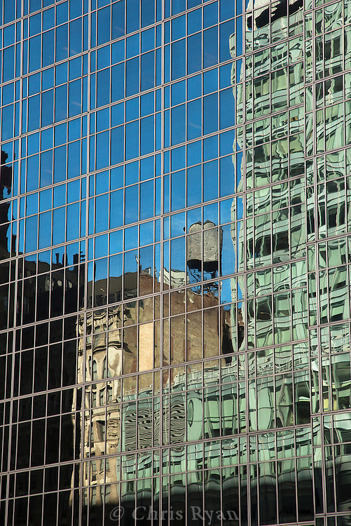 Rooftop water tower reflected in office building, New York City