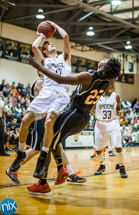 Concord's Connor Burchfield goes up for a shot and is called for a charge against Northwest Cabarrus' Anthony Caldwell Tuesday night at Concord High School. Concord won the game 89-49.