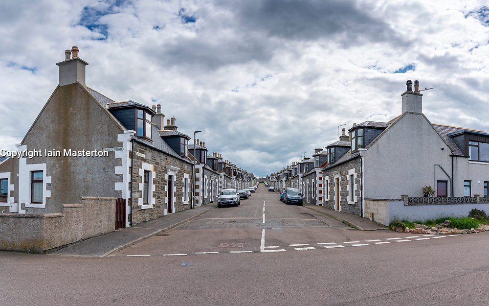 View along street lined with former fishermen's cottages in Portknockie, Moray, Scotland, Uk