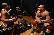 """""""Jaka"""" (l) and Chris Dickinson, wrestling partners for years, talk backstage at the Beyond Wrestling Organization's """"Dream Left Behind"""" event, held at the Center for Arts at the Armory in Somerville, Sunday, Jan. 31, 2016."""