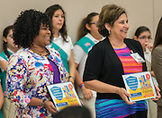 Paulette Caston and Cecilia Gonzales react during a Children at Risk awards presentation to area schools at Pilgrim Academy, June 6, 2016.