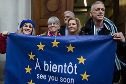 London, UK. 31 January, 2020. Supporters of the UK's membership of the European Union, including Labour MEP Julie Ward (c), pose outside Europe House, home of the European Commission in London, following a procession from Downing Street on the occasion of Brexit Day.