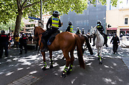 Police horses back up riot police during the Melbourne Freedom Rally at Parliament House. Police move into position on the steps of state parliament ahead of a planed protest. The groups who have organised the many Freedom Day protests over the last 3 months, attempted to march on State Parliament during Melbourne Cup Day demanding the sacking of Premier Daniel Andrews for the lockdown and attacks on their civil liberties. Police met with the protester's with significant force despite the city having had zero cases for five days. (Photo by Dave Hewison/Speed Media)