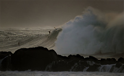 December 13, 2017 - Waimea Bay, HI, USA - WAIMEA BAY, HI - DECEMBER 13, 2017 - 18-22 ft waves break at Waimea Bay. The big wave surfing spot only breaks in the winter when storms send large north swells toward the North Shore of Oahu. (Credit Image: © Erich Schlegel via ZUMA Wire)