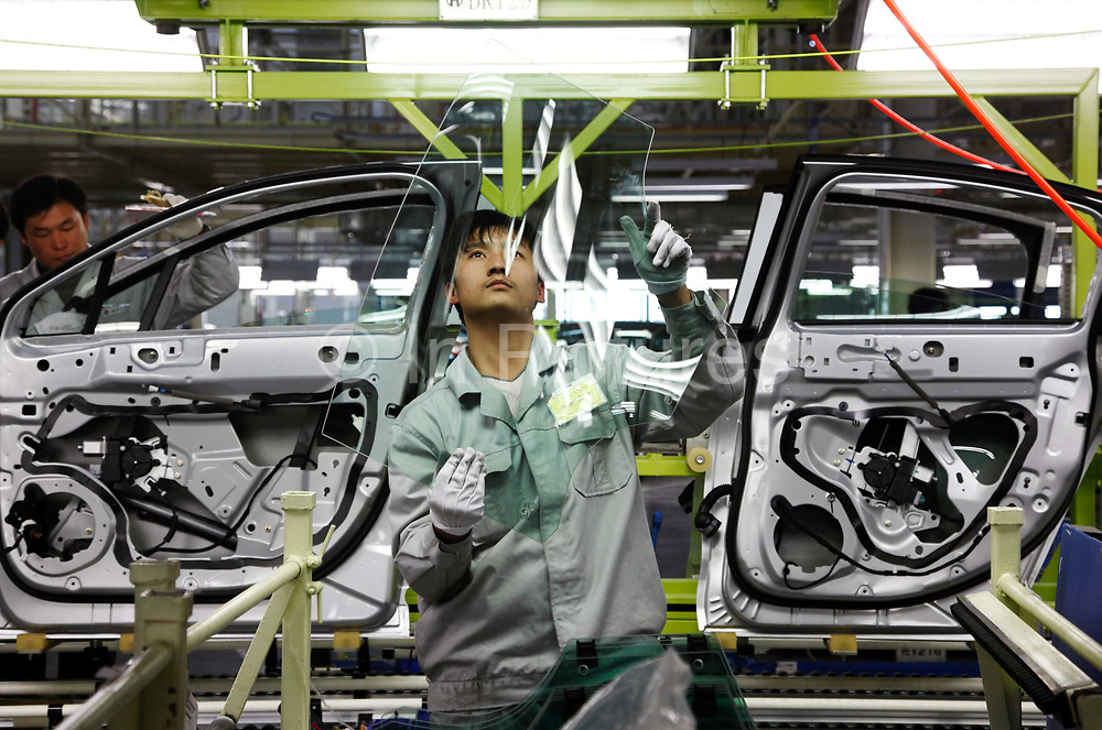 Workers operate on the assembly line at the new Dongfeng Citroen factory in Wuhan, Hubei Province, China on 24 November 2009.  Automakers from across the world are increasingly focusing their efforts on China, the largest auto market in the world and the only major market with prospects of high growth rate. The factory is currently producing the recently introduced C5 Sedans.
