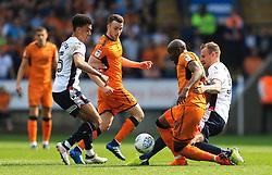 David Wheater of Bolton Wanderers tackles Benik Afobe of Wolverhampton Wanderers - Mandatory by-line: Matt McNulty/JMP - 21/04/2018 - FOOTBALL - Macron Stadium - Bolton, England - Bolton Wanderers v Wolverhampton Wanderers - Sky Bet Championship