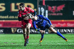 Scarlets' Paul Asquith evades the tackle of Leinster's Noel Reid<br /> <br /> Photographer Craig Thomas/Replay Images<br /> <br /> Guinness PRO14 Round 17 - Scarlets v Leinster - Friday 9th March 2018 - Parc Y Scarlets - Llanelli<br /> <br /> World Copyright © Replay Images . All rights reserved. info@replayimages.co.uk - http://replayimages.co.uk