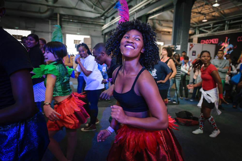Young woman dancing in the Global Village of the 2016 International AIDS Conference in Durban, South Africa.