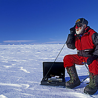 ANTARCTICA, Mount Vaughan Expedition. 88-year old Norman Vaughan talks on satellite phone at Patriot Hills Expedition base.