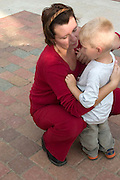 Mom comforting son at Manufaktura providing entertainment culture and shopping. Balucki District Lodz Central Poland