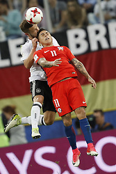 July 3, 2017 - Saint Petersburg, Russia - Eduardo Vargas (R) of Chile national team and Shkodran Mustafi of Germany national team vie for a header during FIFA Confederations Cup Russia 2017 final match between Chile and Germany at Saint Petersburg Stadium on July 2, 2017 in Saint Petersburg, Russia. (Credit Image: © Mike Kireev/NurPhoto via ZUMA Press)