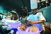 SANYA, CHINA - SEPTEMBER 27: (CHINA OUT)<br /> <br />  A chef tidies up seafood at an undersea restaurant in Haitang Bay on September 27, 2014 in Sanya, Hainan province of China. An undersea restaurant was open in Sanya, which draws 6,000 cubic square water from an ocean and includes more than 400 kinds of marine organisms.<br /> ©Exclusivepix
