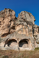 Phrygian and later rock tombs cut into the rocks faces protecting the citadel of Midas . From the 8th century BC . Midas City, Yazilikaya, Eskisehir, Turkey.<br /> <br /> The earliest Phrygian settlement here began in the last quarter of the 8th century BC. Even after the Phrygian kingdom collapsed politically, the city was not abandoned and the Phrygian rock structures and tombs were conserved, with some additions and changes made.in the Persian, Hellenistic, Roman and Byzantine periods. .<br /> <br /> If you prefer to buy from our ALAMY PHOTO LIBRARY  Collection visit : https://www.alamy.com/portfolio/paul-williams-funkystock/ancient-midas-turkey.html<br /> <br /> Visit our CLASSICAL WORLD HISTORIC SITES PHOTO COLLECTIONS for more photos to download or buy as wall art prints https://funkystock.photoshelter.com/gallery-collection/Classical-Era-Historic-Sites-Archaeological-Sites-Pictures-Images/C0000g4bSGiDL9rw