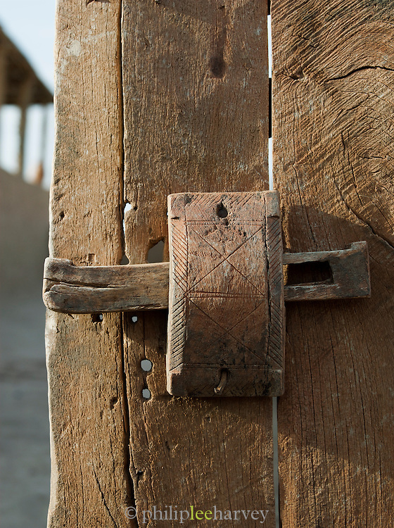 An old wooden latch on a door in the village of Dades in the Skoura Oasis, Morocco