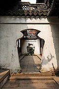Vessel-shaped doorway in Yuyuan Garden, established in 1559. Shanghai, China, 2007