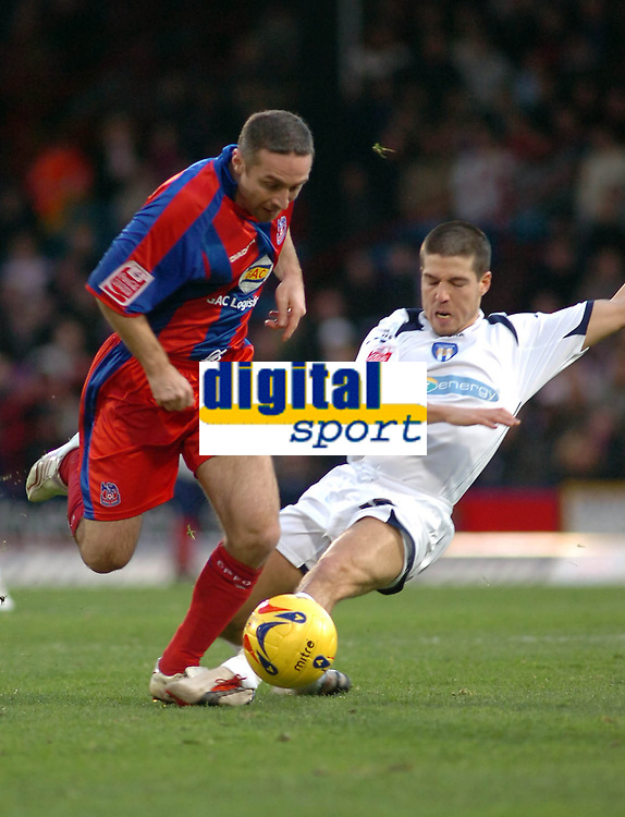 Photo: Kevin Poolman.<br />Crystal Palace v Colchester United. Coca Cola Championship. 09/12/2006. Palace captain Michael Hughes (left) gets away from a Kemal Izzet tackle.