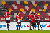 Football - 2020 / 2021 Sky Bet (EFL) Championship - Brentford vs. Wycombe Wanderers  - Brentford Community Stadium<br /> <br /> Brentford players congratulate Tariqe Fosu (Brentford  FC) after he scores his second goal of the game <br /> <br /> COLORSPORT/DANIEL BEARHAM