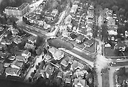 The tremendous size of the Ravenna Boulevard cave-in in relation to surrounding homes and streets is shown clearly in this aerial photograph taken Nov. 15, 1957. (Larry Dion / The Seattle Times)