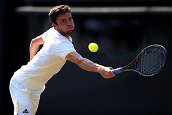 Gilles Simon in action against Dominic Thiem on day four of the Wimbledon Championships at The All England Lawn Tennis and Croquet Club, Wimbledon.