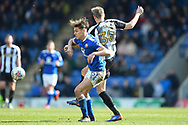 Chesterfield defender Sid Nelson (35) battles with Notts County forward Jonathan Stead (30) during the EFL Sky Bet League 2 match between Chesterfield and Notts County at the b2net stadium, Chesterfield, England on 25 March 2018. Picture by Jon Hobley.