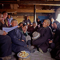 """MONGOLIA, Darhad Valley herders discuss local issues at a """"bag"""" (township) meeting, practicing newly-established democracy."""