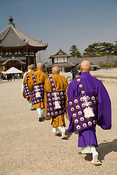 Asia, Japan, Honshu island, Nara, buddhist monks walk in procession honoring Buddha's birthday at Kofukuji Temple, a U.N. world heritage site