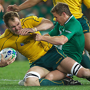 Rocky Elsom, Australia, is tackled during the Australia V Ireland Pool C match during the IRB Rugby World Cup tournament. Eden Park, Auckland, New Zealand, 17th September 2011. Photo Tim Clayton...