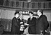 30/03/1963<br /> 03/30/1963<br /> 30 March 1963<br /> Gael - Linn Annual Debating Competition  for Secondary Schools awards presented at the Shelbourne Hotel, Dublin. Ailin Hudson, O'Connell Schools, Dublin, Individual Winner, receiving the Corn Gael Linn trophy from Aongus O hEochaidh (Bord Gael-Linn). Also in the picture are Dr. P. Hillery, Minister for Education and Domhnall O'Morain (Cathaoirleach Gael-Linn).