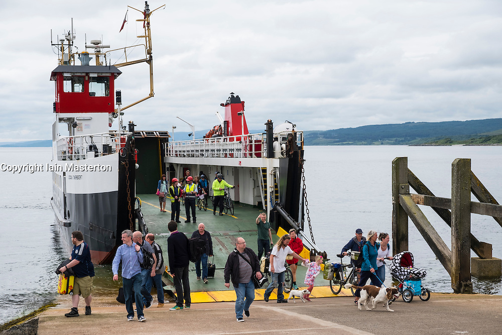 Passengers disembarking from Caledonian Macbrayne ferry at Claonaig on Kintyre Peninsula from Lochranza on Arran in Scotland UK