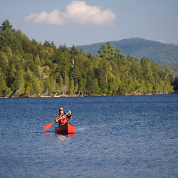 Canoeing on Prong Pond near Moosehead Lake in Maine.  Owned by Plum Creek. (MR)