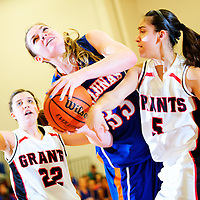 12513  Adron Gardner<br /> <br /> Grants Pirate Haley Hall (22), left, looks on as Los Lunas Tiger Teige Zeller (33) ties up with Pirate Eileen Kuygler (5) at Grants High School in Grants Friday.