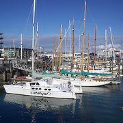 Moored yachts in Viaduct Basin. Auckland, New Zealand, .Located in the heart of Auckland City, Viaduct Basin and Harbour is a first class residential, commercial and entertainment precinct..The marina caters to commercial vessels, pleasure craft and super yachts with 150 marina berths ranging in size up to 60 metres..Viaduct Basin hosts many fabulous events including the past America's Cup defences, Louis Vuitton Regattas, the Volvo Round the World Race stopover, Auckland International Boatshow and New Zealand Fashion Week..Visitors can explore New Zealand's rich maritime history at Voyager Maritime Museum, cruise the harbour on a charter yacht, view the yachts berthed in the harbour and enjoy the world class hospitality at the many bars and restaurants that line the waters edge..New Zealand's largest marine service precinct, Westhaven, lies a short walk to the west.. Auckland, New Zealand. 2nd November  2010. Photo Tim Clayton..