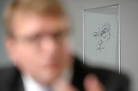 03 JAN 2008, BERLIN/GERMANY:<br /> Ein Bild von Konrad Adenaer im Hintergrund von Ronald Pofalla, CDU Generalsekretaer, waehrend einem Interview, in seinem Buero, Konrad-Adenauer-Haus<br /> IMAGE: 20080103-01-005