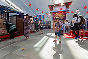 A boy plays with a spinning top at a traditional funfair for kids during the Edo festival at Haneda International Airport terminal, Tokyo, Japan. Friday August 26th 2016. The 3 day festival runs from August 26th to August 28th at Tokyo's second International airport. Actors dressed as samurai, geisha and ninja will greet passengers and visitors to the terminal and put on shows and parades of traditional music and dance. Haneda International airport has an Edo theme. Edo is the old name for Tokyo in the time of the samurai