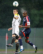 The Rams' Cole DeNormandie, left, and the Revolution's Kalifa Cisse battle for the ball during a match between the New England Revolution and the Boston Real Rams on Tuesday at Veterans Stadium in New Britain. (Photo by Kevin Bartram)