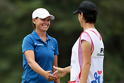 June 16, 2018 - Belmont, Michigan, United States - Lee-Anne Pace of South Africa celebrates with her caddie after her birdie on the 18th green during the third round of the Meijer LPGA Classic golf tournament at Blythefield Country Club in Belmont, MI, USA  Saturday, June 16, 2018. (Credit Image: © Jorge Lemus/NurPhoto via ZUMA Press)