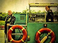 Two men standing on a boat