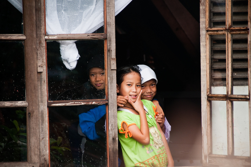 Indonesia, Java. Little girls in traditional Indonesian house.