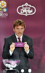 ZBIGNIEW BONIEK (POLAND) SHOWS THE TICKET OF AUSTRIA DURING THE EUFA EURO 2012 QUALIFYING DRAW IN PALACE SCIENCE AND CULTURE IN WARSAW, POLAND..THE 2012 EUROPEAN SOCCER CHAMPIONSHIP WILL BE HOSTED BY POLAND AND UKRAINE...WARSAW, POLAND , FEBRUARY 07, 2010..( PHOTO BY ADAM NURKIEWICZ / MEDIASPORT / SPORTIDA.COM ).
