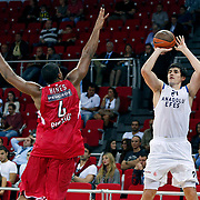 Anadolu Efes's Ersan ILYASOVA (R) during their Two Nations Cup basketball match Anadolu Efes between Olympiacos at Abdi Ipekci Arena in Istanbul Turkey on Sunday 02 October 2011. Photo by TURKPIX