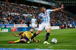 Joel Lynch of Huddersfield is challenged by Andy Delort of Wigan  - Photo mandatory by-line: Rogan Thomson/JMP - 07966 386802 - 16/09/2014 - SPORT - FOOTBALL - Huddersfield, England - The John Smith's Stadium - Huddersfield Town v Wigan Athletic - Sky Bet Championship.