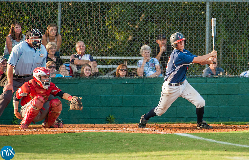 Concord Post 51's Mitchell Helms hits against Rowan County Tuesday night at Central Cabarrus High School. Concord won the game 7-6 in the second game of a best-of-five game playoff series.
