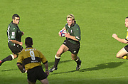 Reading, Berkshire, 29/09/02<br /> London Irish vs Wasps,<br /> Exiles Justin BISHOP, looking to break the Wasps defensive line during the ZURICH PREMIERSHIP RUGBY match at the Madejski Stadium,  [Mandatory Credit: Peter Spurrier/Intersport Images],
