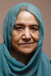 Portrait of elderly south Asian woman.