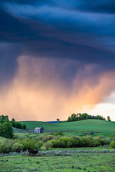 Severe storm at sunset casting new light on an old derelict homestead in the rolling agricultural hills of eastern Idaho. <br /> <br /> This print can be printed 30X45 @183dpi native resolution.  Larger than that with some digital surgery.