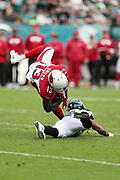 Arizona Cardinals wide receiver Jaron Brown (13) is upended by Philadelphia Eagles defensive back Patrick Robinson (21) as he catches a fourth down pass for a gain of 6 yards but short of a first down at the Eagles 32 yard line during the 2017 NFL week 5 regular season football game against the against the Philadelphia Eagles, Sunday, Oct. 8, 2017 in Philadelphia. The Eagles won the game 34-7. (©Paul Anthony Spinelli)